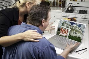 bigstock-couple-in-kitchen-using-laptop-4610162